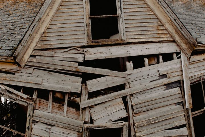 wooden damaged abandoned rustic house in village