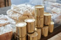 gold round coins in clear plastic pack